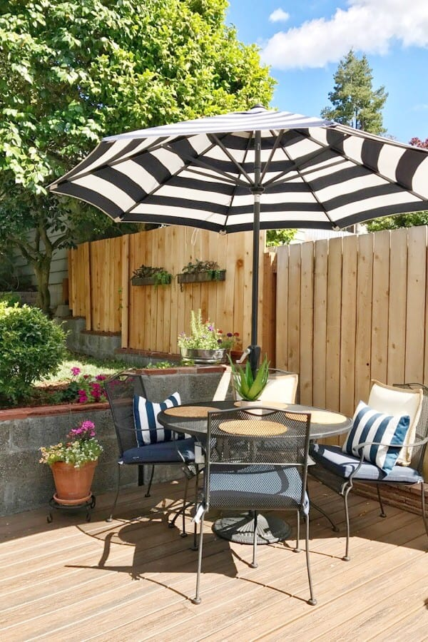 table with umbrella and chairs outdoors