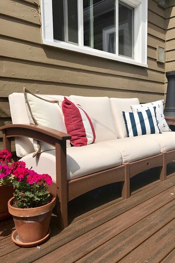 white outdoor couch with flowers