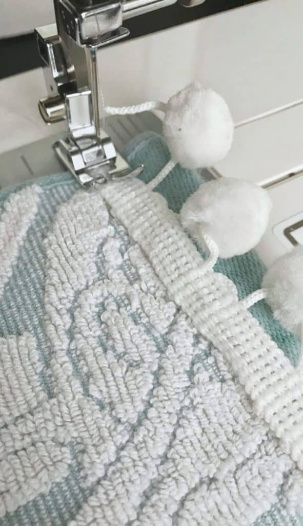 sewing pom pom trim on bathroom hand towels