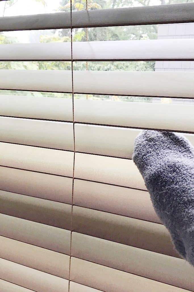 Use a fuzzy sock over your hand to clean window blinds.