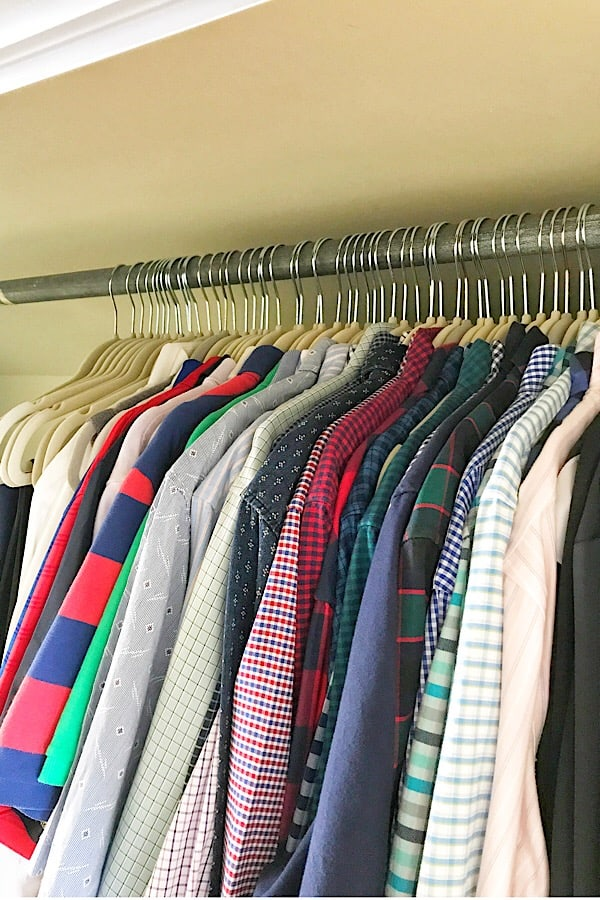 closet with shirts hanging