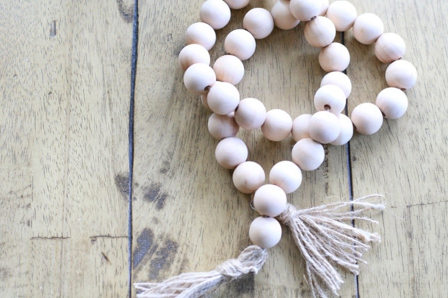 Want to add Instant Style to your Rooms? Here's a quick, easy and cheap way with a DIY wood bead garland.