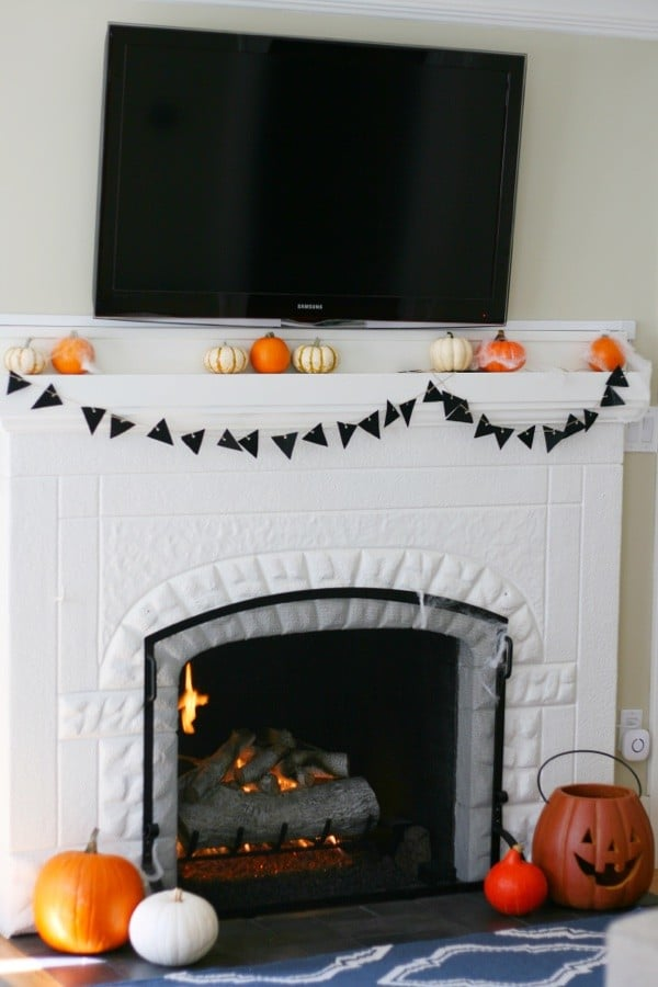 Showing a fireplace with a halloween triangle banner
