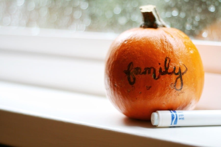 Write what you're thankful for on mini pumpkins