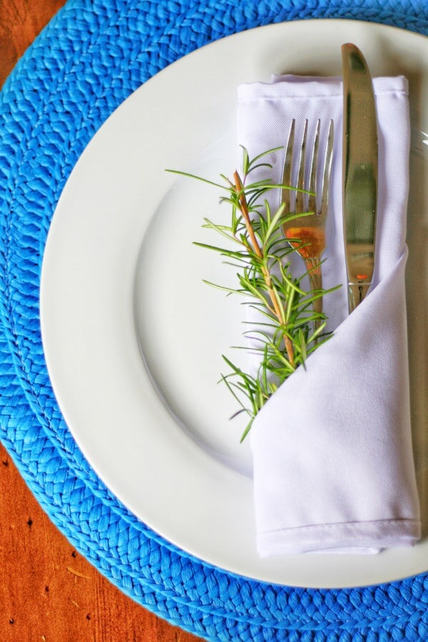 Sprigs of rosemary tucked in napkins