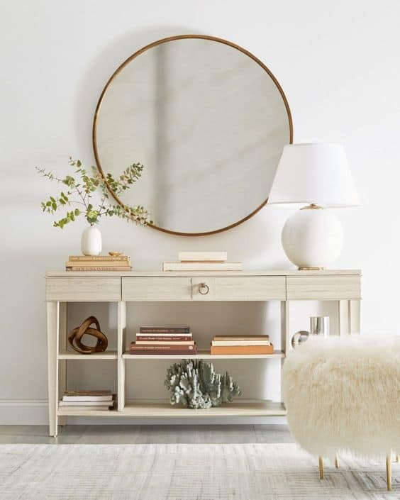 large round mirror in an entryway