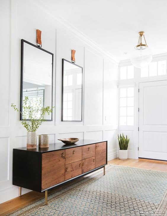 Amber Lewis Designs - large entryway with double mirror and minimal accessories