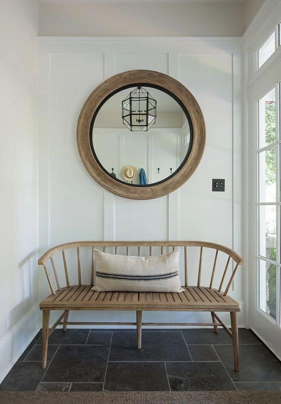 Beautiful rustic bench and mirror for this small foyer area