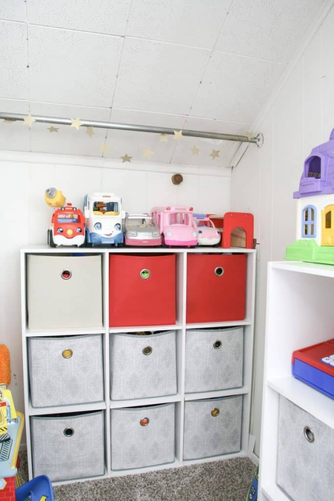 A cube storage unit can hold kids blocks, play food, matchbox cars etc.