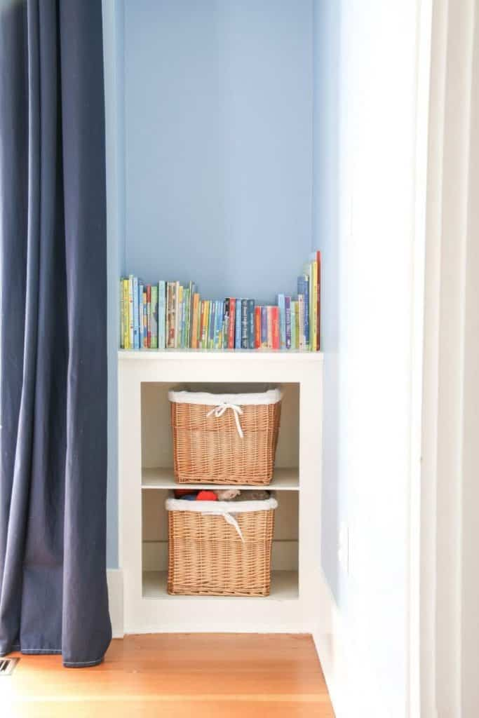 A sneak peek into our home! A book nook with basket lined shelves.