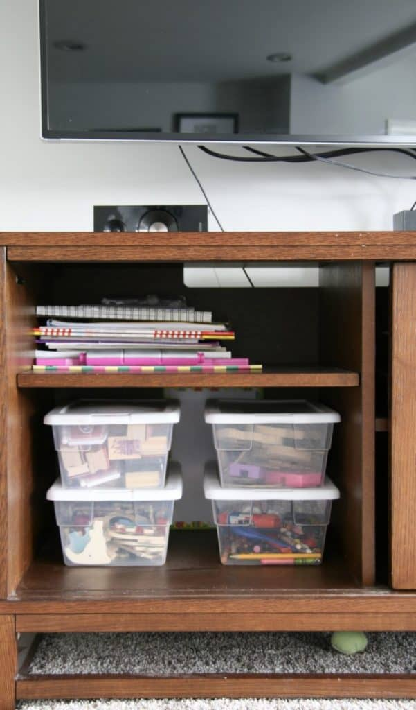 Use a TV Console to hold kids art stuff, magnets and stamps!