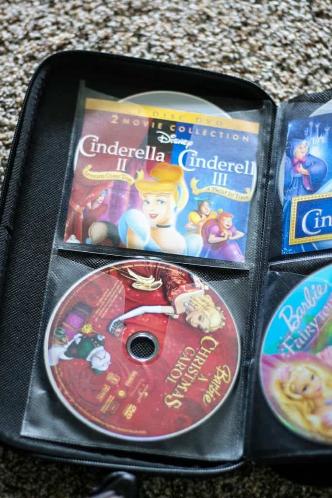 Take the DVDs out of the cases and store in a CD case. Easy for kids to choose movies!