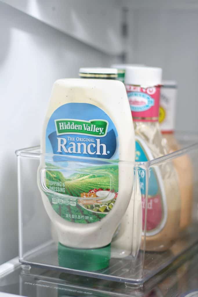 Clear bins in the fridge are great for corraling yogurts, salad dressings and condiments