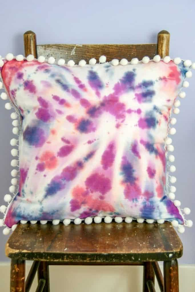 DIY Tie-Dye Pillows! This is a fun project to add a pop of color to your pillow decor. Add some pom poms too!