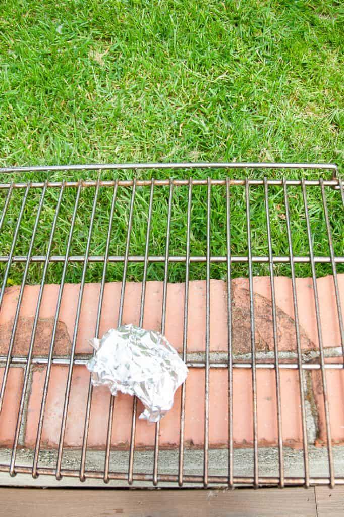 Scrub Oven Racks Outside with Aluminum Foil