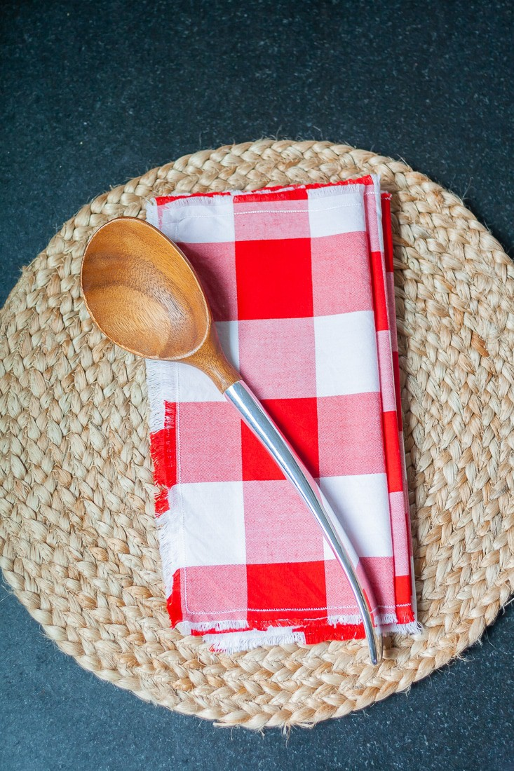 Learn how to make frayed edge napkins! Why buy a pretty set of napkins when it's so easy to make your own? This project can be done with any fabric. In this tutorial, I made red gingham frayed edge napkins just in time for summer! These would look great on your table at your BBQs and summer parties. These can also be used as basket liners for bread or appetizer plates.