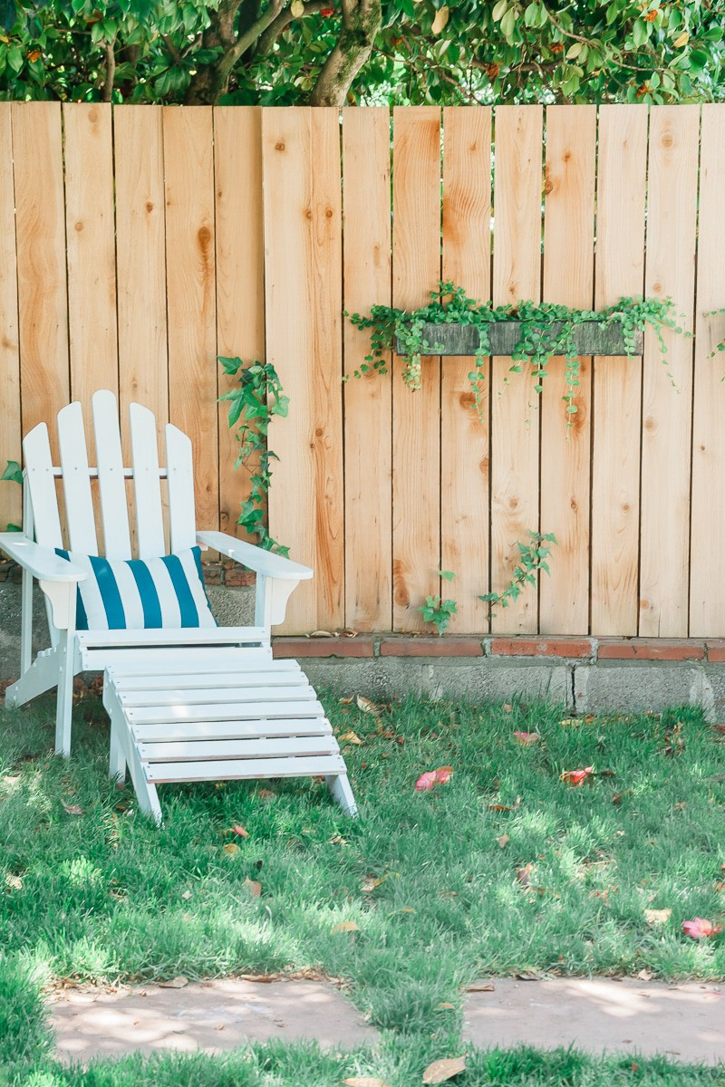 This post will show you how I repaired and spray painted wooden adirondack chairs, including what spray paint I used and tips and tricks to help you along the way. Painting an outdoor chair is not as hard as you think and you will fall in love with your adirondack chairs again! Click through to get ideas for painting adirondack chairs.