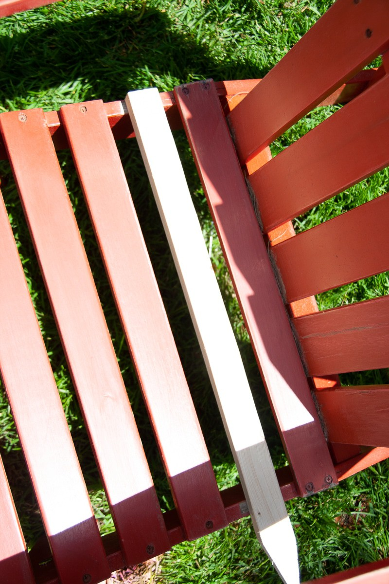 Fix a slat in your wood Adirondack Chair with a sturdy wood garden stake.