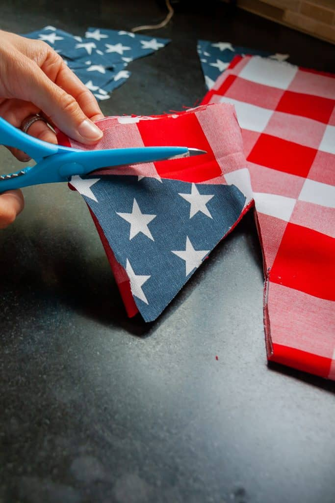 Cut your fabric into triangles for the bunting