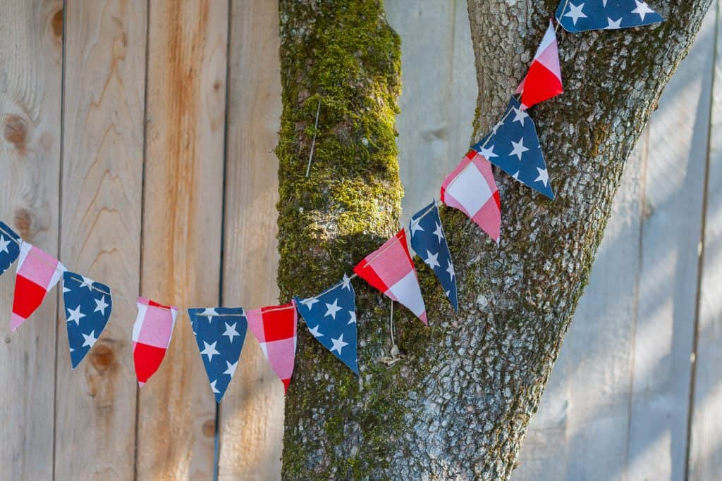Hey you guys! Today I created a little 4th of July Banner. With twenty minutes and a little red, white and blue fabric - you can create this cute decor item for summer. I actually saw a really cute patriotic banner at Pottery Barn and that served as my inspiration. This is so easy to do. Read on!