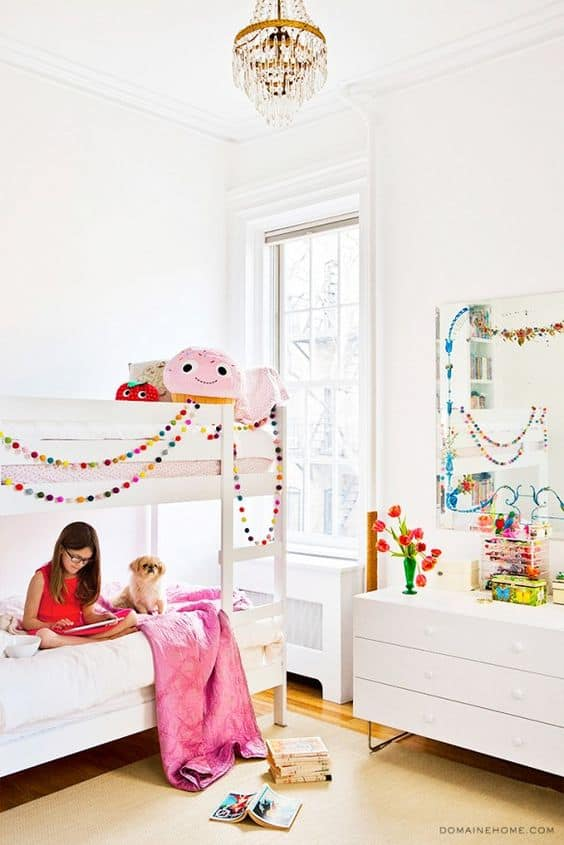 Pom Pom Garland showing hanging on a bed in a kids room