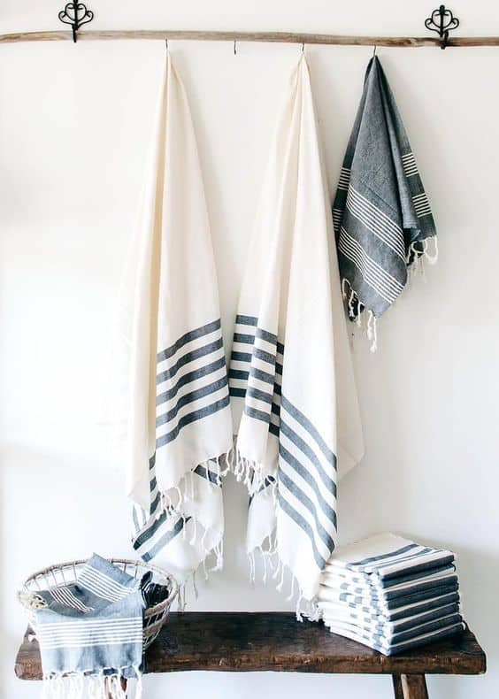 Towels and fabric hanging on peg rail