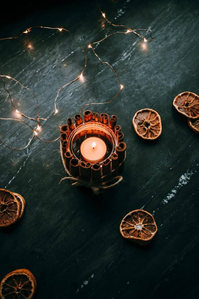 Easy Tutorial for these Rustic DIY Cinnamon Stick Candle Holders.  #christmascrafts #christmasdecor #cinnamon