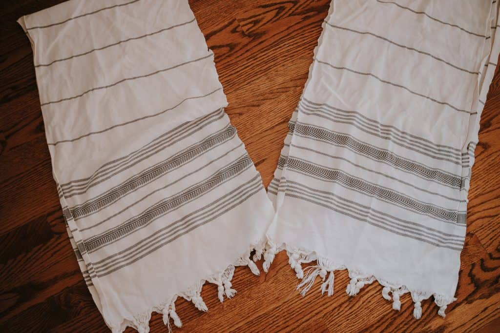 Cut a turkish towel in half and sew up the edges