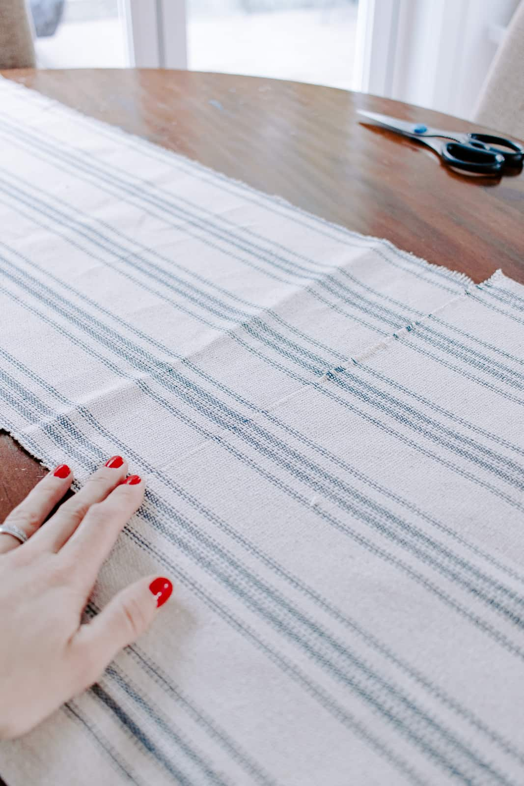 diy christmas table runner - sew a seam and line up the stripes