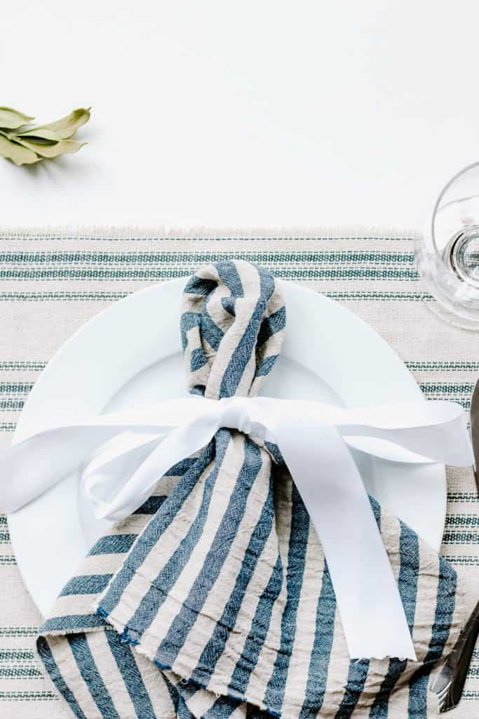 DIY Christmas Table Runner + Our Holiday Tablescape - Make this beautiful DIY Christmas Table Runner and get some inspiration with our holiday tablescape.