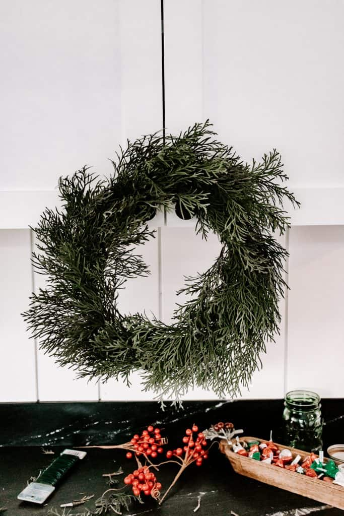 Learn how to make a real diy evergreen wreath for Christmas! This one only takes about ten minutes to make and is practically free! #christmas #christmasdecor #christmascrafts #wreath
