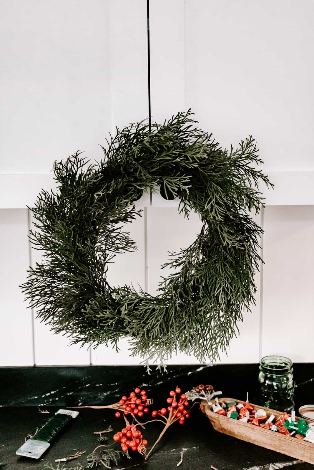 DIY Evergreen Wreath you Can Make in 10 Minutes - Learn how to make a real DIY evergreen wreath for Christmas! This one only takes about ten minutes to make and is practically free !