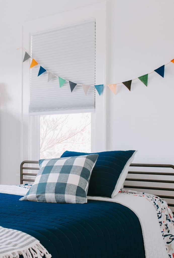 Felt Bunting hanging above bed