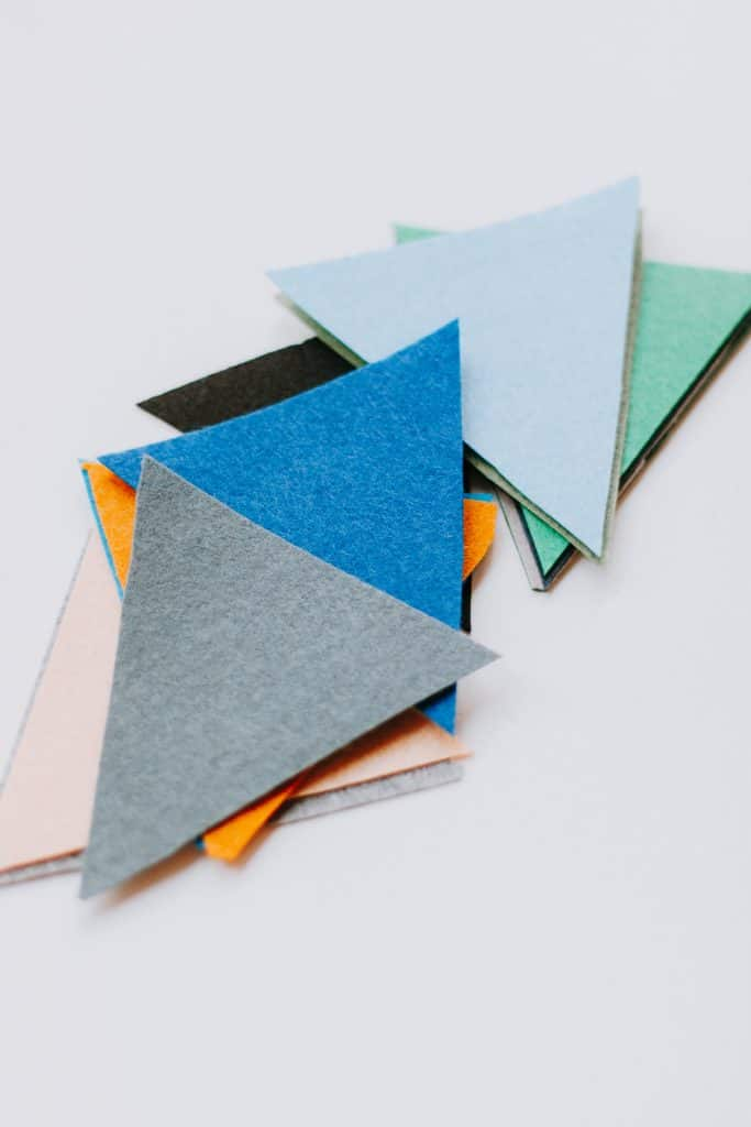 Felt pieces cut in triangles for bunting
