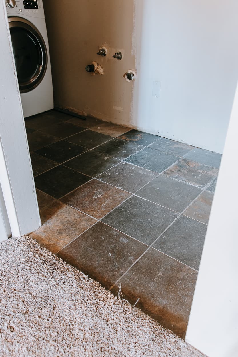 Budget Laundry Room Makeover for under $115 - See the before and after of our budget laundry room makeover. I managed to spruce up this room for less than two hundred bucks and I'm breaking down everything I did.