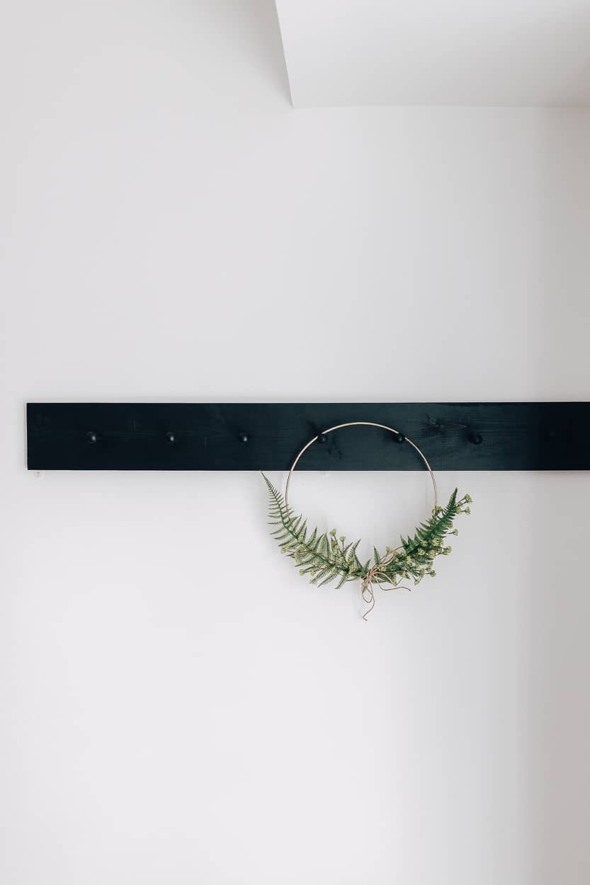 black peg rail with wreath