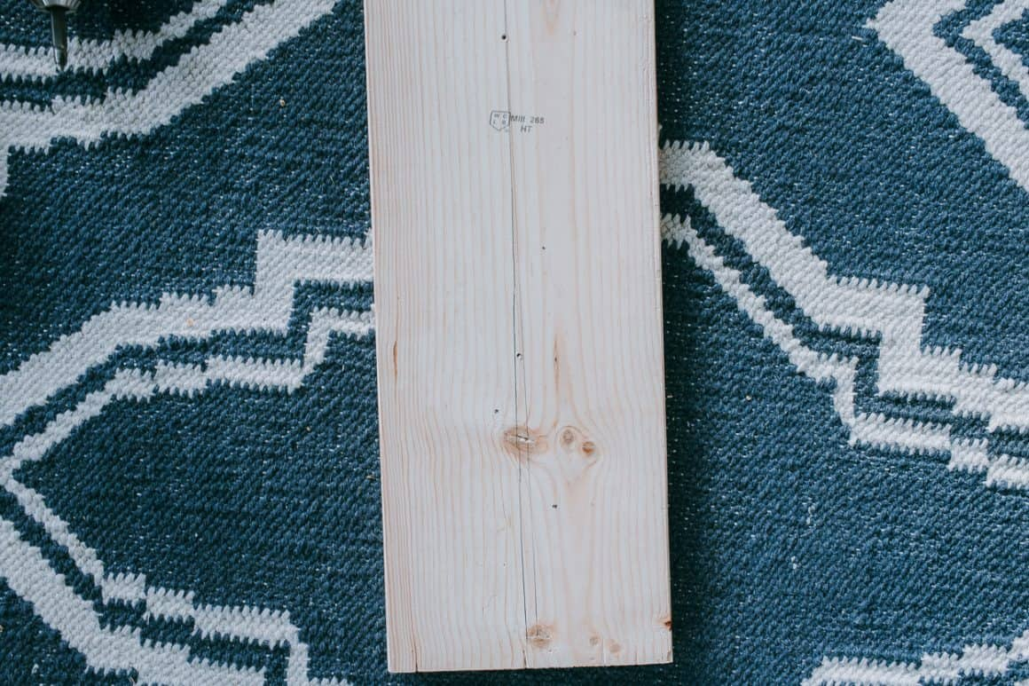 Mark off where you want your pegs on a board.