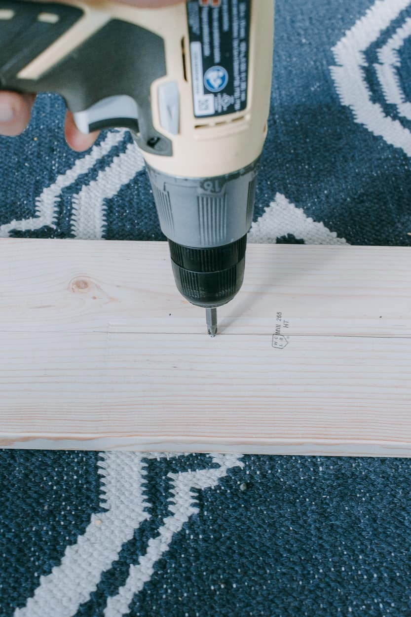 Drill holes into wood for pegs