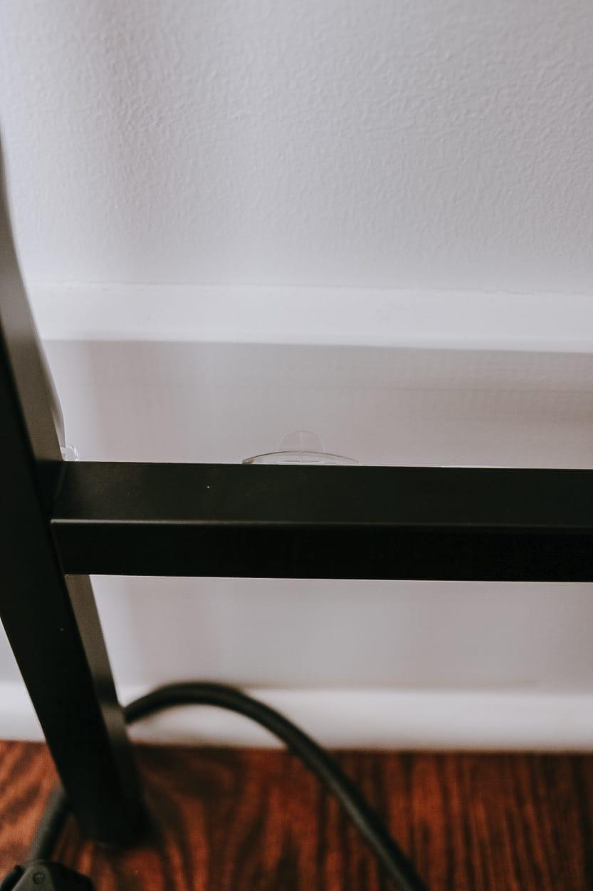 Command Light Clips attached along desk legs can help keep cords hidden