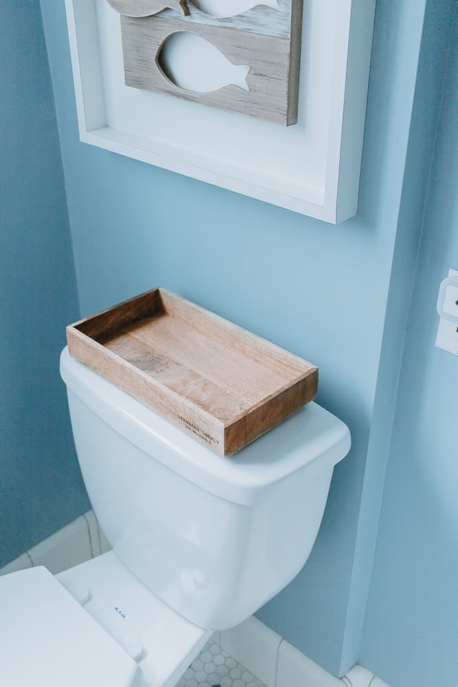back of toilet tray for extra bathroom storage space