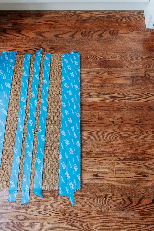 DIY Painted Doormat - IKEA Hack + VIDEO - Make this cute and custom DIY Painted Doormat! Using a Cheap IKEA doormat and some inexpensive spray paint and painter's tape, you can make this stylish striped doormat.