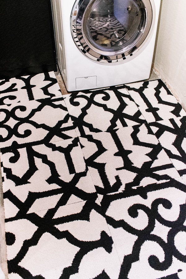 Ideas for how to cover an ugly floor - inexpensive and renter friendly solutions.  Click through to get all the ideas!