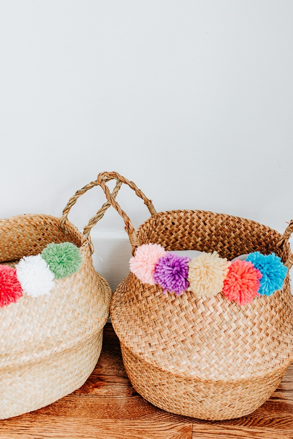 Make this DIY Pom Pom Belly Basket with just a few inexpensive materials! #diy #pompoms