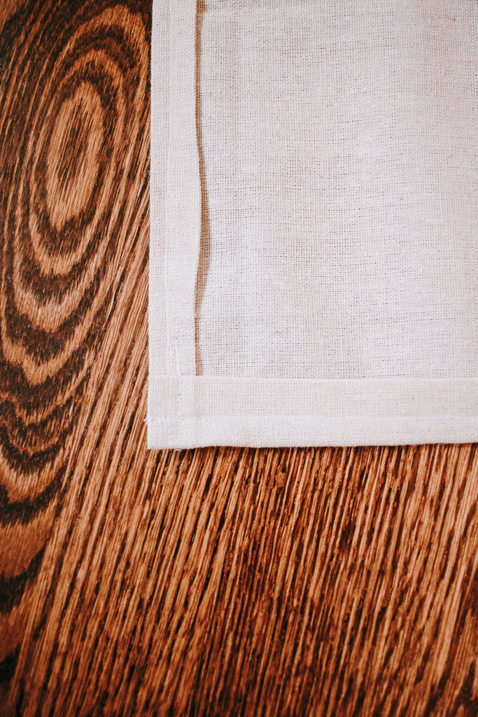 How to Make DIY Faux Roman Shades with Tension Rods - In this easy tutorial, you will learn how to make DIY faux roman shades with tension rods.  Don't spend hundreds of dollars on custom shades, just use this method to create your own.