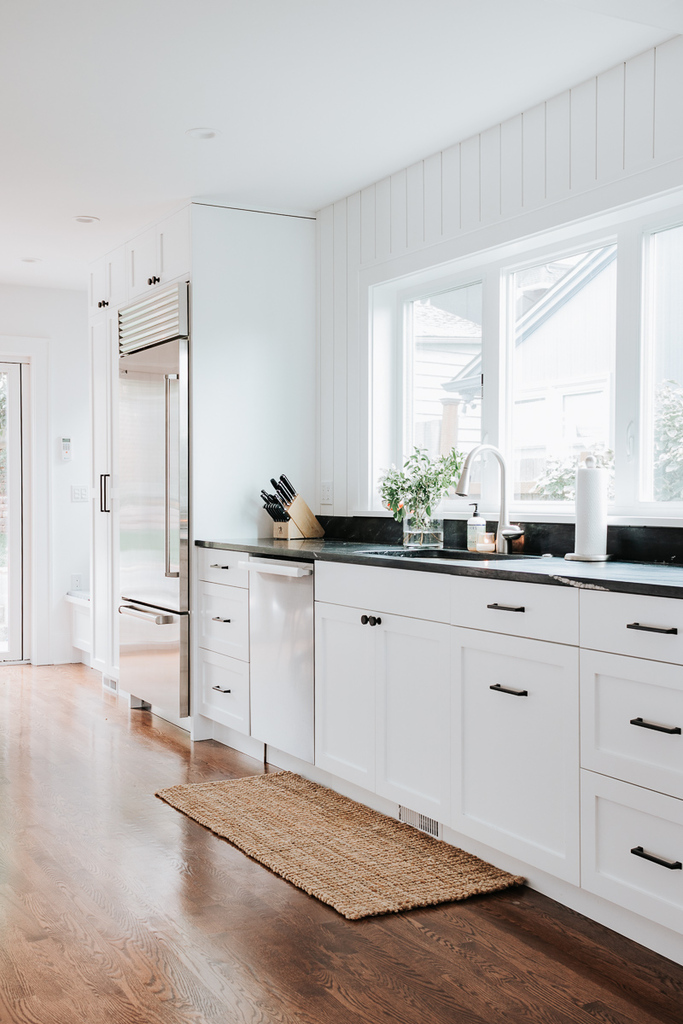 white vertical shiplap sub zero refrigerator soapstone countertops