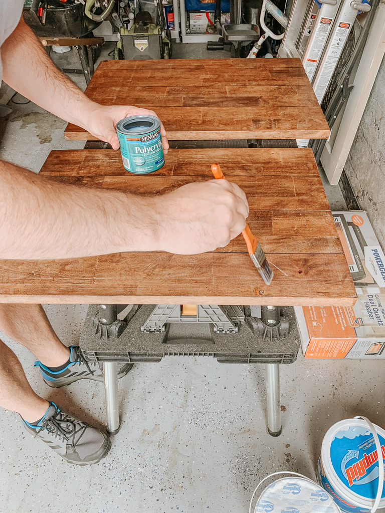 Apply minwax clear coat to tabletop.