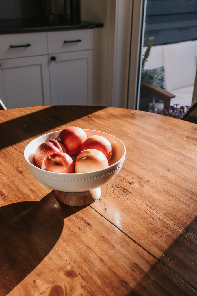 Pedestal Bowl with Fruit on Kitchen Table