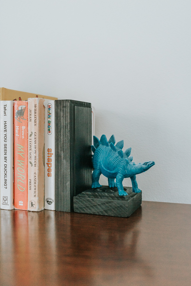 Adorable DIY Wooden Bookends - A super easy tutorial for making a pair of DIY wooden bookends. These bookends are cheap to make and you can even customize them!