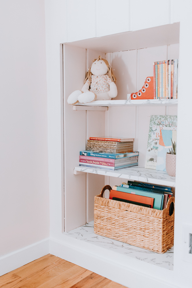 How to Revamp a Bookcase with Peel and Stick Wallpaper - Add some character to a basic bookshelf by wallpapering shelves. Here I show you how I took inexpensive peel and stick wallpaper to create a unique look that anyone can create.