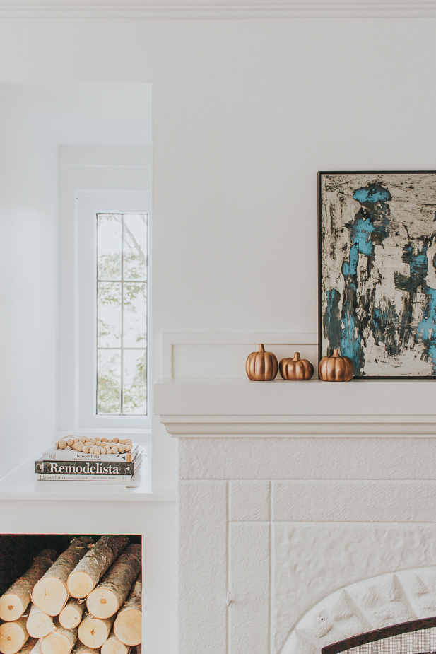 Copper Pumpkins and candles on a mantel. Fall Decorating ideas
